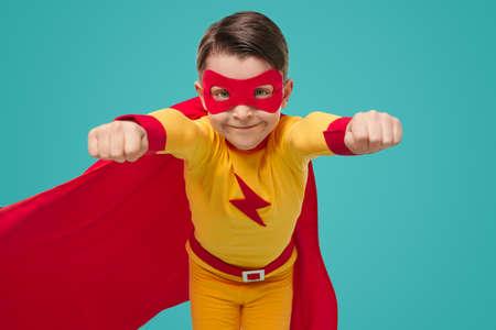 Superhero kid in super hero costume