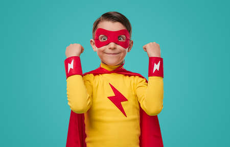 Excited superhero kid with funny face