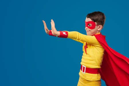 Superhero kid using superpower