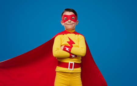 Confident kid in superhero costume and mask