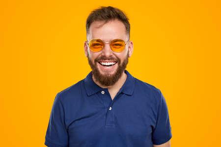 Happy bearded man in sunglasses