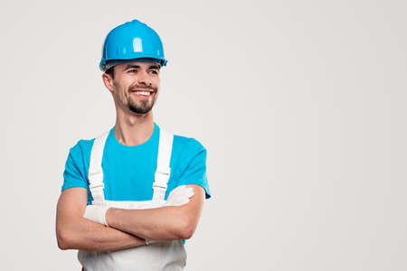 Confident foreman construction man in overall and hardhat