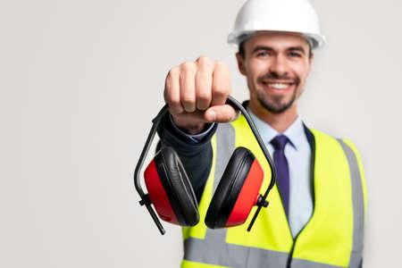Happy construction engineer with protective headphones 免版税图像