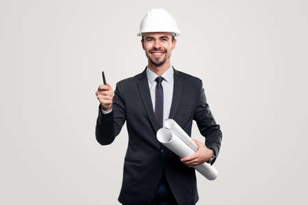 Smiling contractor with drafts and pen