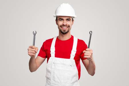 Friendly handyman with professional tools 免版税图像