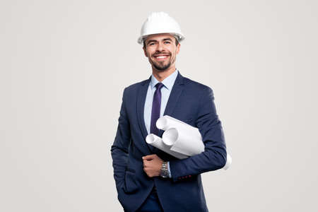 Successful engineer in suit with blueprints