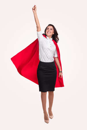 Powerful woman flying with red cape