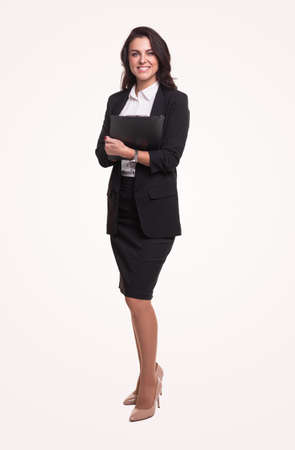 Smiling businesswoman in suit with folder