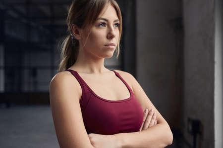 Confident sportswoman standing in gym