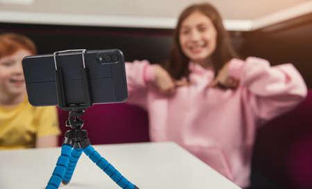Kids recording video on smartphone