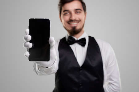 Waiter showing smartphone with blank screen