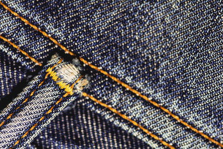 tatter: Seams of jeans to show abrasion and tear after being used.