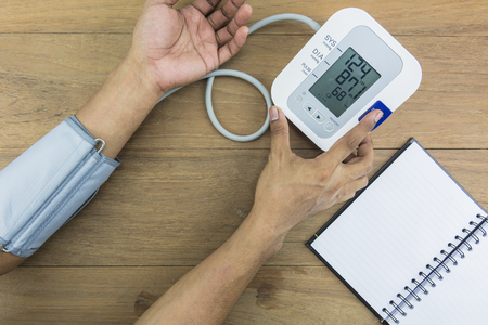 diastolic: Measuring blood pressure, Pulse, Measuring heart rate. Stock Photo
