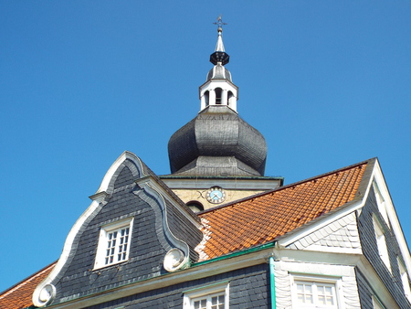 pious: Tower of the Evangelical City Church Lennep on gable houses, Remscheid-Lennep, Germany, 31 07 2014 The city church was rebuilt in Baroque style after a fire in the middle of the 18th century