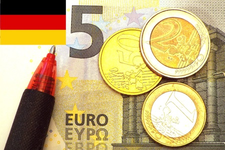 German Minimum wage 8.50 The German minimum wage as 5 euro note and coins.