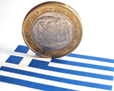 Greece crisis - A Greek Euro with the owl and the Greek flag. Standard-Bild
