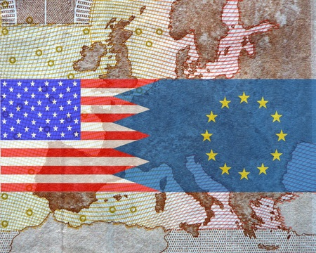 lobbyists: TTIP American and European flag in front of a map of Europe.