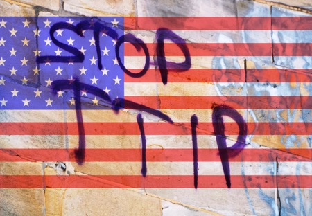 lobbyists: TTIP The words quotStop TTIPquot before the American flag Stock Photo