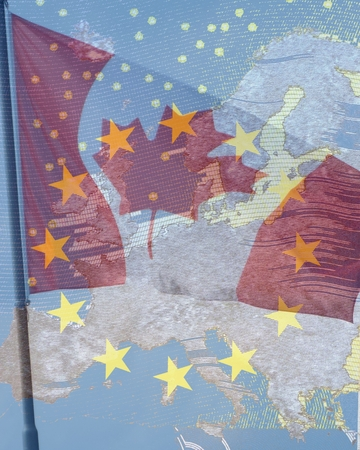 harmonization: CETA - the Comprehensive Economic and Trade Agreement - Canadian flag behind the transparent Europe flag with the star wreath in front of the map of Europe Stock Photo