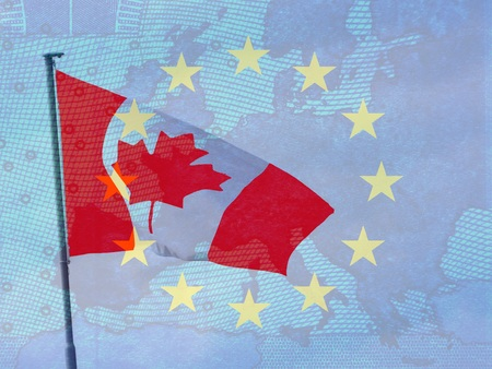 CETA - the Comprehensive Economic and Trade Agreement - Canadian flag behind the transparent Europe flag with the star wreath in front of the map of Europe Stock Photo