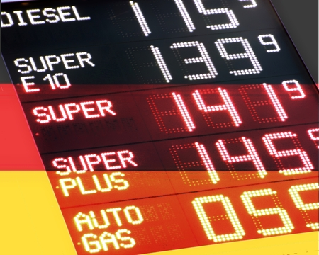 co2 emissions: Gasoline prices in Germany - The German flag is superposed by a transparent display panel for gasoline prices Stock Photo