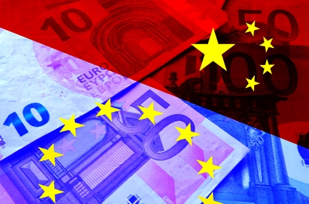 emerging economy: Europe and China Through the European and Chinese flag euro bills are shining
