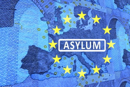 seekers: Asylum in Europe -On the map of Europe is the lettering ASYLUM. Surrounded by the European Circle of Stars.