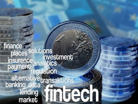 enabling: FinTech - Word cloud to FinTech (financial technology). Background: Euro bills, blue Stock Photo