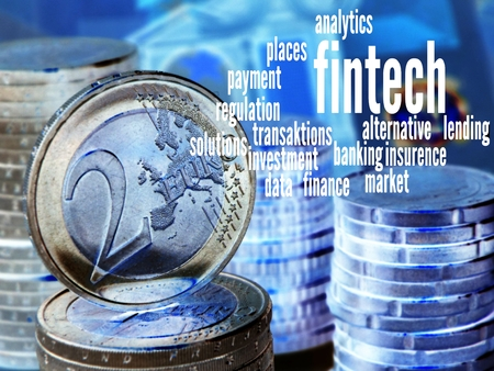 aggregator: FinTech - Word cloud to FinTech (financial technology). Background: columns of coins with a visible two-Euro coin,