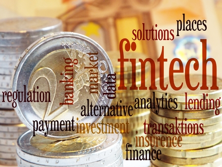 enabling: FinTech - Word cloud to FinTech (financial technology). Background: columns of coins with a visible two-Euro coin,