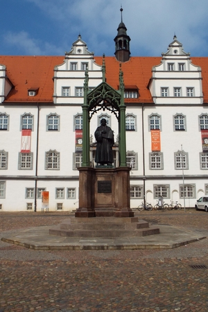 reformer: Monument Luther on the Market Place in front of the townhall, Wittenberg, Germany 12.04.2016 At the door of the Castle Church in Wittenberg reformer Martin Luther nailed his 95 theses. By Luther and Melanchthon, the Wittenberg wurde the center of the Refo