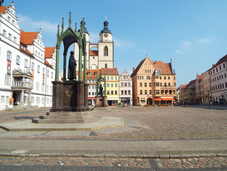 Market Place before the City Council with the monuments of Luther and Melanchthon, Wittenberg, Germany 04.12.2016 At the door of the Castle Church in Wittenberg reformer Martin Luther nailed his 95 theses. By Luther and Melanchthon, the Wittenberg wurde t