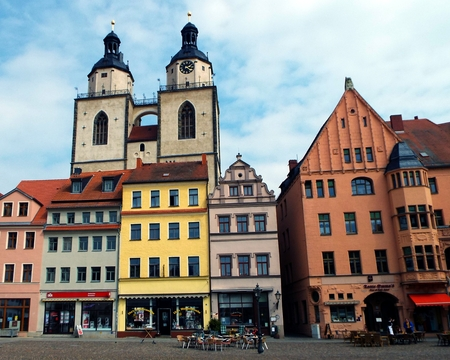 reformer: Towers of St. Marys Church, Wittenberg, Germany 04.12.2016 - At the door of the Castle Church in Wittenberg reformer Martin Luther nailed his 95 theses. By Luther and Melanchthon, the Wittenberg wurde the center of the Reformation.
