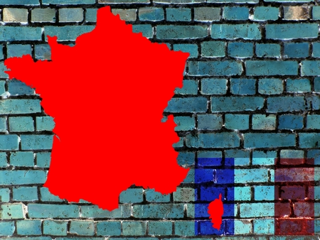 Topics to France (background) On a gray-blue brick wall you can see the map of the France. Given the national flag.