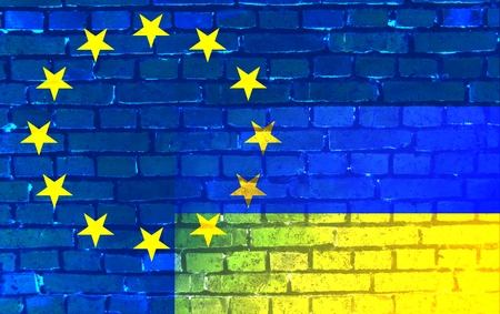 rapprochement: Relationship EU - Ukraine: The Ukrainian flag (bottom right) extends into the circle of stars of the European flag. Stock Photo