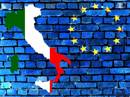Italy and the EU - The map of Italy in the national colors, right next to the European circle of stars against a blue brick wall as background. Stock Photo