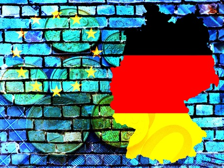 The map of Germany in the colors of the national flag in front of a bluish brick wall with the European circle of stars. Translucent: Euro coins. Standard-Bild