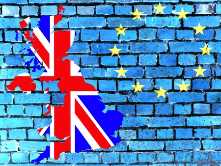 Britain and the EU - The map of Great Britain in the national colors in front of a blue brick wall with the European circle of stars.