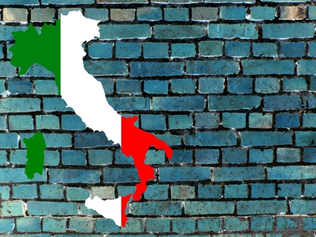 Italy and the EU - The map of Italy in the national colors against a blue brick wall as background. Standard-Bild