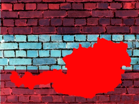 Topics to Austria (background) - The red map of Austria against a brick wall in the national colors. Standard-Bild