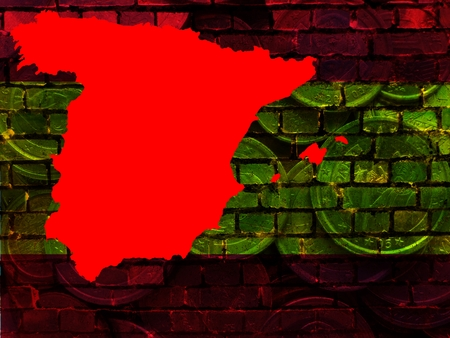 Spain and the EU - financial problems -The red map of Spain is projected on a brick wall in the national colors. Translucent: Euro coins. Standard-Bild