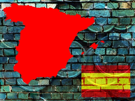 Spain and the EU - financial problems - The red map of Spain is projected on a bluish brick wall. Right below the national flag. Translucent: Euro coins.