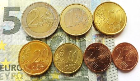 minimum wage: Germany minimum wage increase - Increased The German minimum wage from 2017th as 5 euro note and coins. Stock Photo