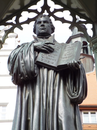 Monument Luther on the Market Place in front of the townhall, Wittenberg, Germany 04.12.2016 - At the door of the Castle Church in Wittenberg reformer Martin Luther nailed his 95 theses. By Luther and Melanchthon, the Wittenberg wurde the center of the Re