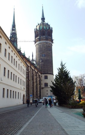 Tower of the Castle Church of All Saints, Wittenberg, Germany 04.12.2016 - At the door of the Castle Church in Wittenberg reformer Martin Luther nailed his 95 theses. By Luther and Melanchthon, the Wittenberg wurde the center of the Reformation.