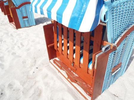 Preseason at the Baltic Sea - Partial view of a blue beach basket on a sandy beach.