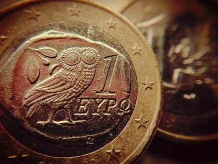 The owl of wisdom on a one euro coin - A Greek euro coin with the Athenian owl,