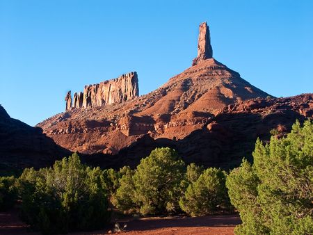 nuns: Priest & Nuns, and Castle Rock, Castle Valley, Utah with Clear Deep Blue Sky and vivid Gree Foliage