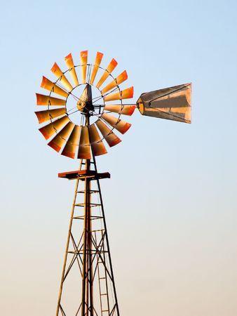 Windmill glows warm in the Setting Sun photo