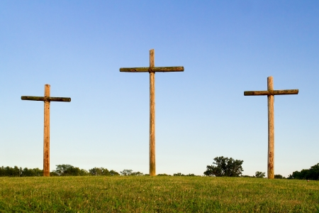 crucify: Three Wooden Crosses on Horizon Stock Photo